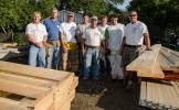 Brent Stutzman, left, Duke Realty Construction Operations Manager, and other volunteers on a 2014 build first volunteer day.